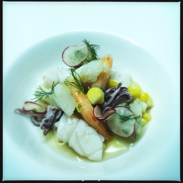Light seafood salad with a cold spiced broth